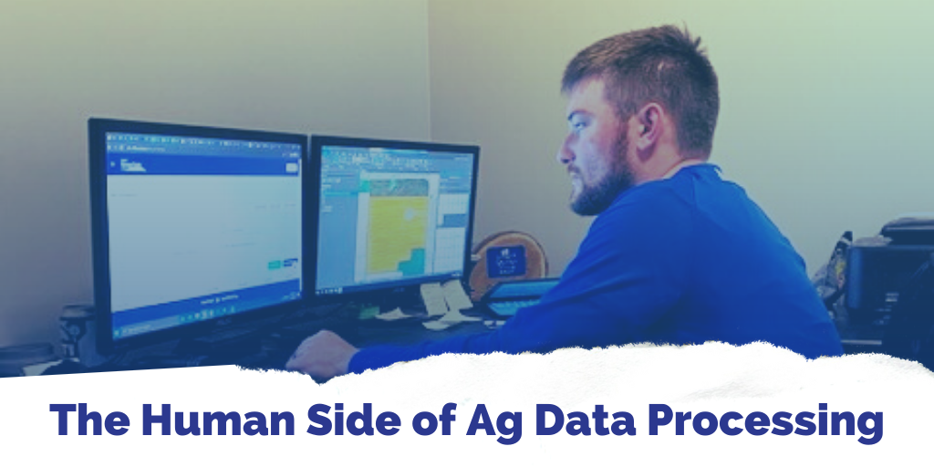 Agronomist Colton Mills looks at farm data on a computer