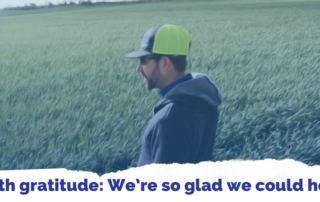 IN10T CEO Kevin Heikes stands in a field with a farmer